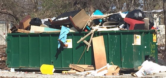 Overflowing Dumpster In Mobile Home Park