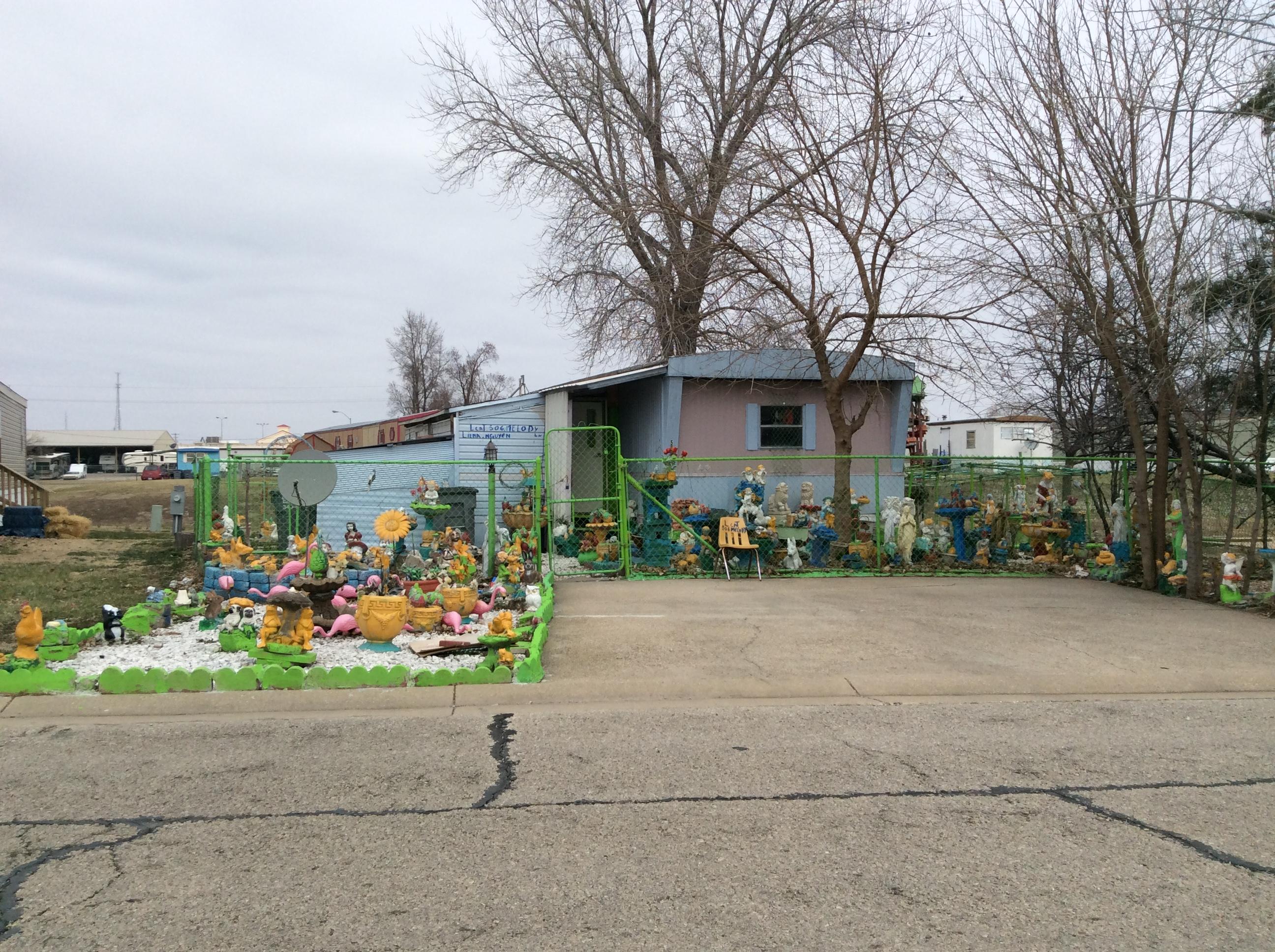 bizarre mobile home yard