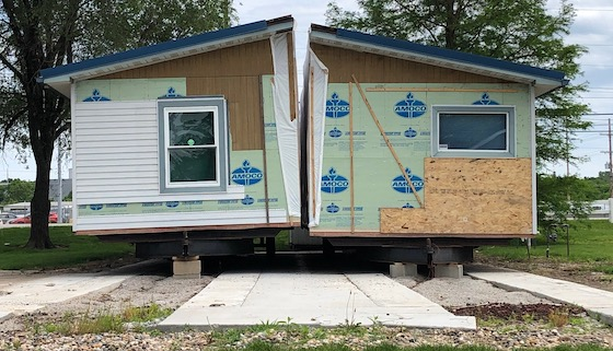 doublewide mobile home being assembled