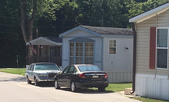 cars in front of mobile home